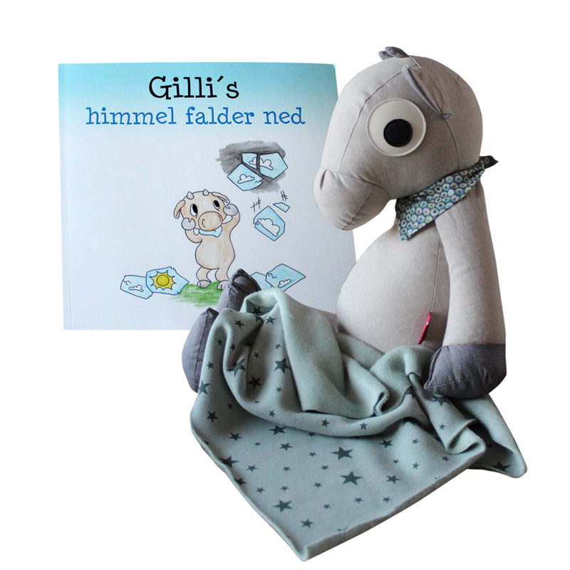 Gilli is with both book and a blanket