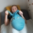 Child plays with Otto, the sensory heat pad